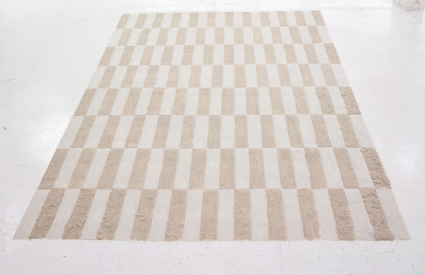 Sand Rug (Ikea 2) Sculpture by Martin Oppel. Sand in two tones. Dimesions Variable.